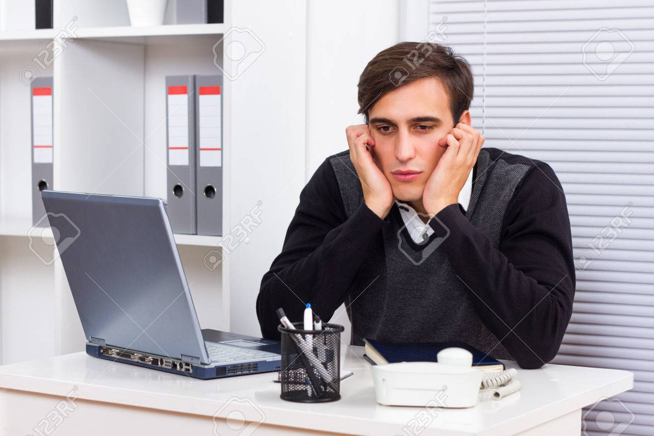 25195046-young-businessman-got-fed-up-of-working.jpg