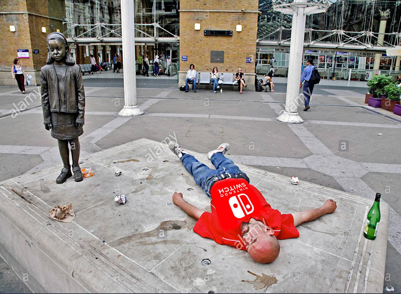 an-englsih-football-fan-asleep-and-drunk-outside-liverpool-street-AMPTAJ.jpg